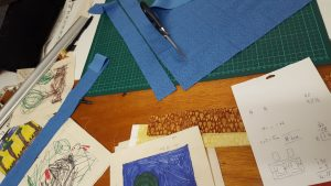 calculations complete, strips being cut and placed about the pictures.